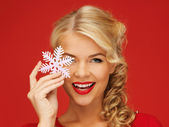 Lovely woman in red dress with snowflake — Стоковое фото