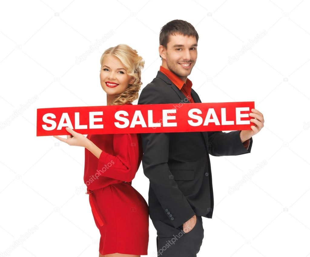 Bright picture of man and woman with sale sign — Stock Photo #14094376