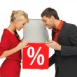 Man and woman with percent sign - Stock Photo