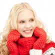 Beautiful woman in mittens — Stock Photo #14232633