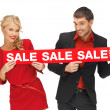 Man and woman with sale sign — Stock Photo #14292469