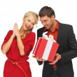 Man and woman with present — Stock Photo #14292671