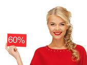 Hermosa mujer en vestido rojo con tarjeta de descuento — Foto de Stock