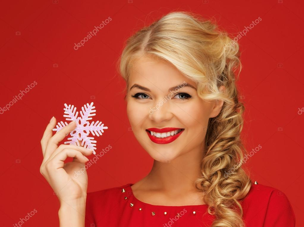 Picture of lovely woman in red dress with snowflake — Stock Photo #14419225