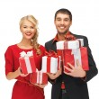 Man and woman with gift boxes — Stock Photo #14420171