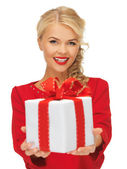 Lovely woman in red dress with present — Fotografia Stock
