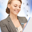 Happy woman with big notepad — Stock Photo #14494883