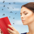 Calm and serious woman with book - Stock Photo