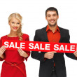Royalty-Free Stock Photo: Man and woman with sale sign