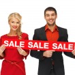 Man and woman with sale sign — Stock Photo #14495671