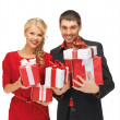 Man and woman with gift boxes — Stock Photo #14495813