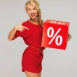 Lovely woman in red dress with percent sign — Stock Photo #14495853