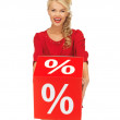 Lovely woman in red dress with percent sign — Stock Photo #14495875