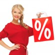 Beautiful woman in red dress with shopping bag — Stock Photo #14495901