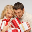 Romantic couple in a sweaters with gift boxes — Stock Photo #14496075