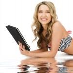 Woman in bikini with tablet pc computer — Stock Photo #14496461