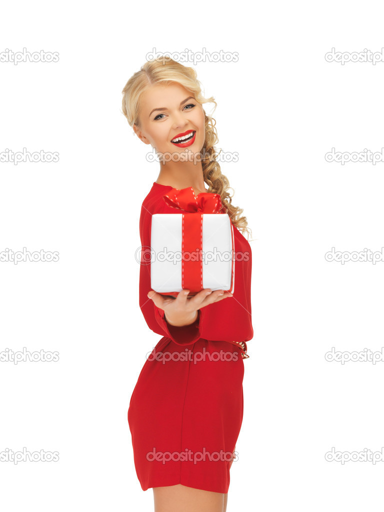 Picture of lovely woman in red dress with present — Stock Photo #14495979