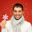 Man in warm sweater and scarf with snowflake — Stock Photo #14545949