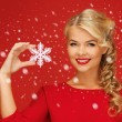 Lovely woman in red dress with snowflake — Lizenzfreies Foto