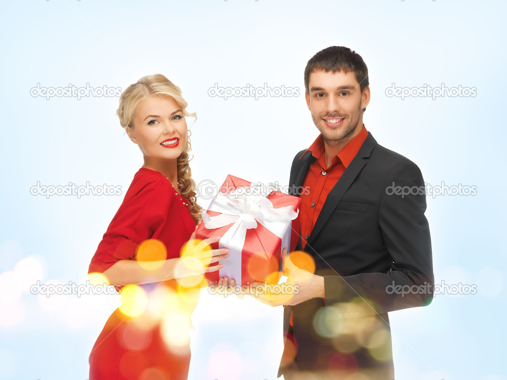 Picture of man and woman with present  Stock Photo #14542155