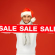 Handsome man in christmas hat - Stock Photo