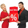 Man and woman with percent sign — Stock Photo