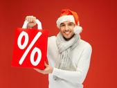 Gut aussehender mann in weihnachtsmütze — Stockfoto