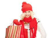 Junges mädchen mit einkaufstaschen — Stockfoto