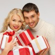 Romantic couple in a sweaters with gift boxes — Foto Stock