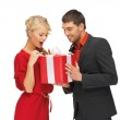 Man and woman with present — Stock Photo #14878411