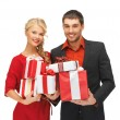 Man and woman with gift boxes — Stock Photo #14878439