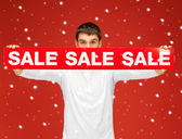 Man holding sale sign — Stock Photo