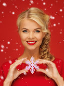 Lovely woman in red dress with snowflake — Stock Photo