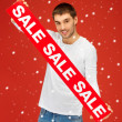 Handsome man with sale sign — Stock Photo #14888243