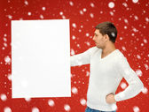 Handsome man with big blank board — Stock Photo