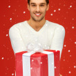 Handsome man with a gift — Foto Stock