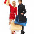 Man and woman with shopping bags — Stock Photo