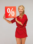 Lovely woman in red dress with percent sign — Stockfoto