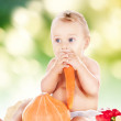 Baby boy with vegetables - Stock Photo