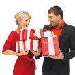 Man and woman with gift boxes — Stock Photo #15437695