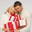 Royalty-Free Stock Photo: Romantic couple in a sweaters with gift boxes