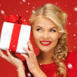 Lovely woman in red dress with present — Stock Photo #15438085