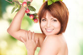 Happy woman with apple twig — Stock Photo