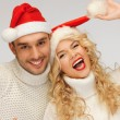 Royalty-Free Stock Photo: Family couple in sweaters and santa's hats