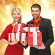 Royalty-Free Stock Photo: Man and woman with gift boxes