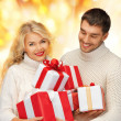 Royalty-Free Stock Photo: Family couple in a sweaters with gift boxes
