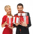 Man and woman with gift boxes — Stockfoto