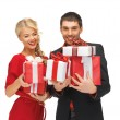 Man and woman with gift boxes — Stock Photo