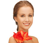 Lovely woman with red lily flower — Stock Photo