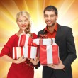 Man and woman with gift boxes — Stock Photo #15786431